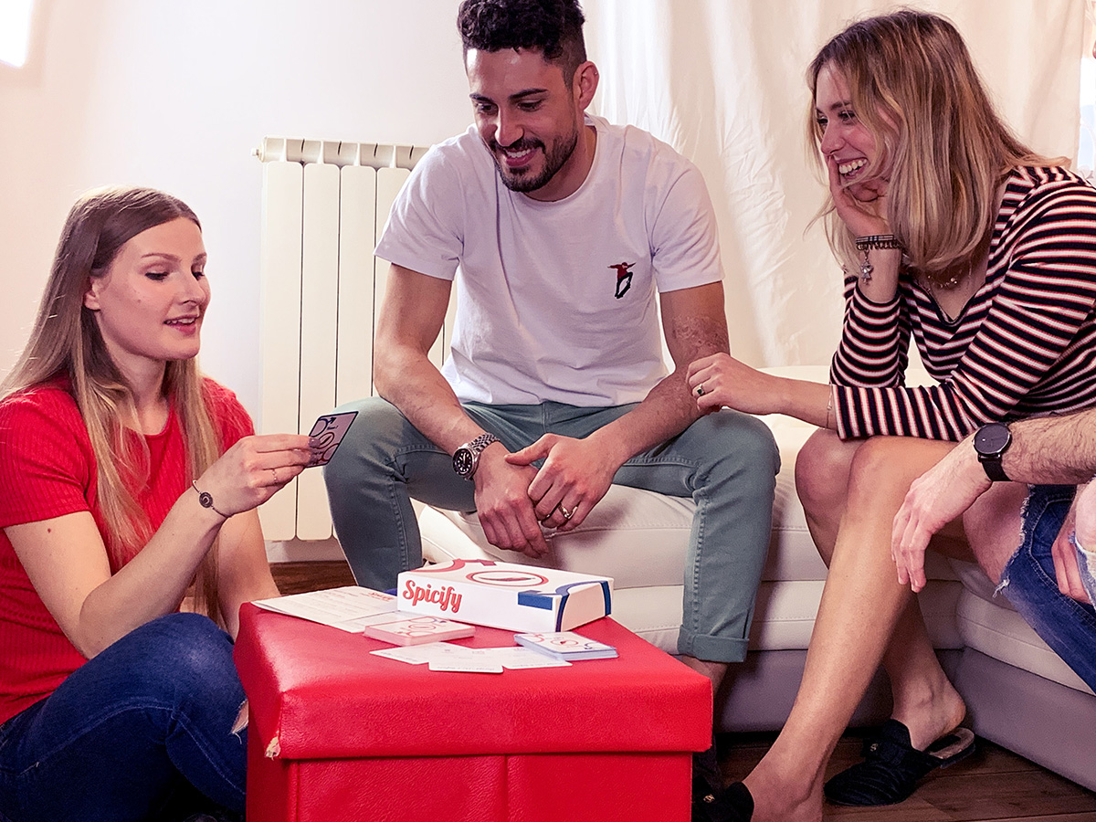 two girls and two guys playing Spicify Card game